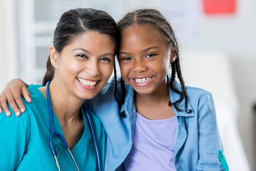 Female healthcare provider and young girl